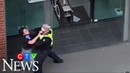 'He's choking me': Police officer grabs woman's neck