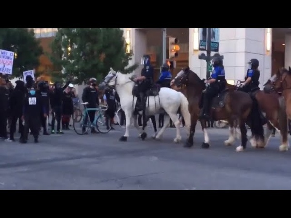 Austin Police on horsebacks breaking up BLM Antifa crowds occupying intersection