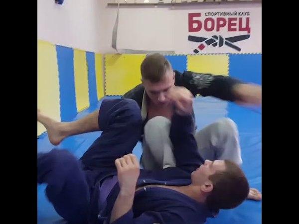 Roman Nepota demonstrates Armbar from reverse De La Riva Guard during training