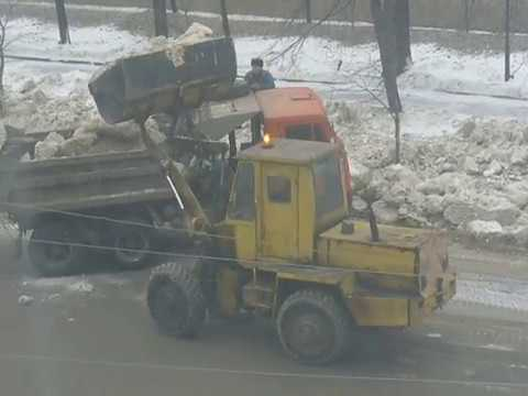 Old soviet loader TO-30 loadin dirt snow