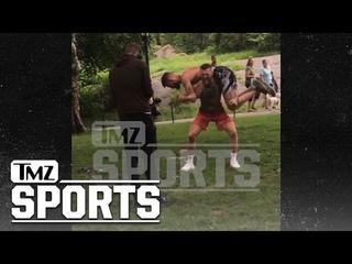 Conor McGregor Squats a Human Man In Central Park | TMZ Sports