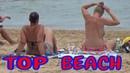 TOP BEACH Naked girl smokes on the beach Spanish Topless beach Hot Summer Video