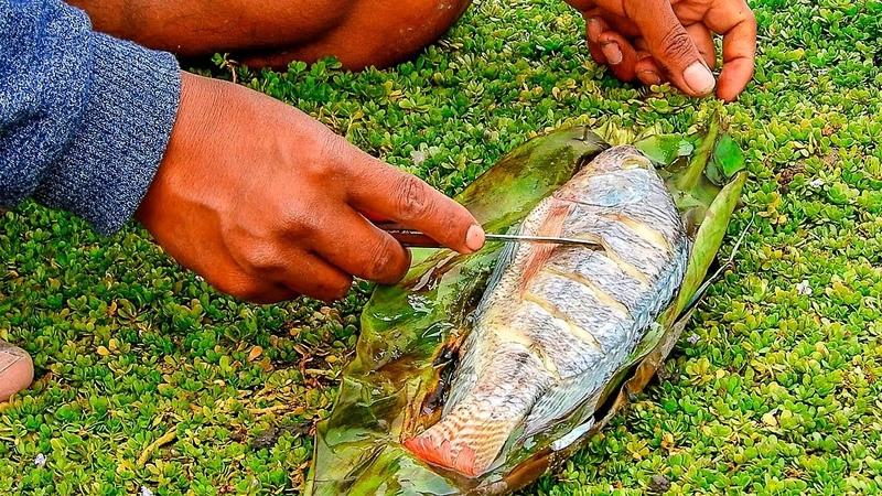 Mira la asombrosa técnica de cocinar el pescado How to cook fish with clay