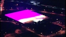 From above Green City Growers Greenhouse give off a purple light in the sky