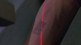 Начертание шрихкод на руку, метка зверя! Было показано в фильме «Крепость» ещё в 1992 году!