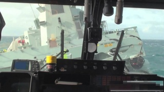 Lynx helicopter landing on ship in rough sea